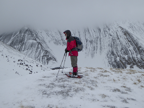 On the top with the lower slopes of Mt. Galatea under heavy cloud.
