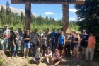 Elk Valley Students Erect a Cedar Log Portal at Elk Pass